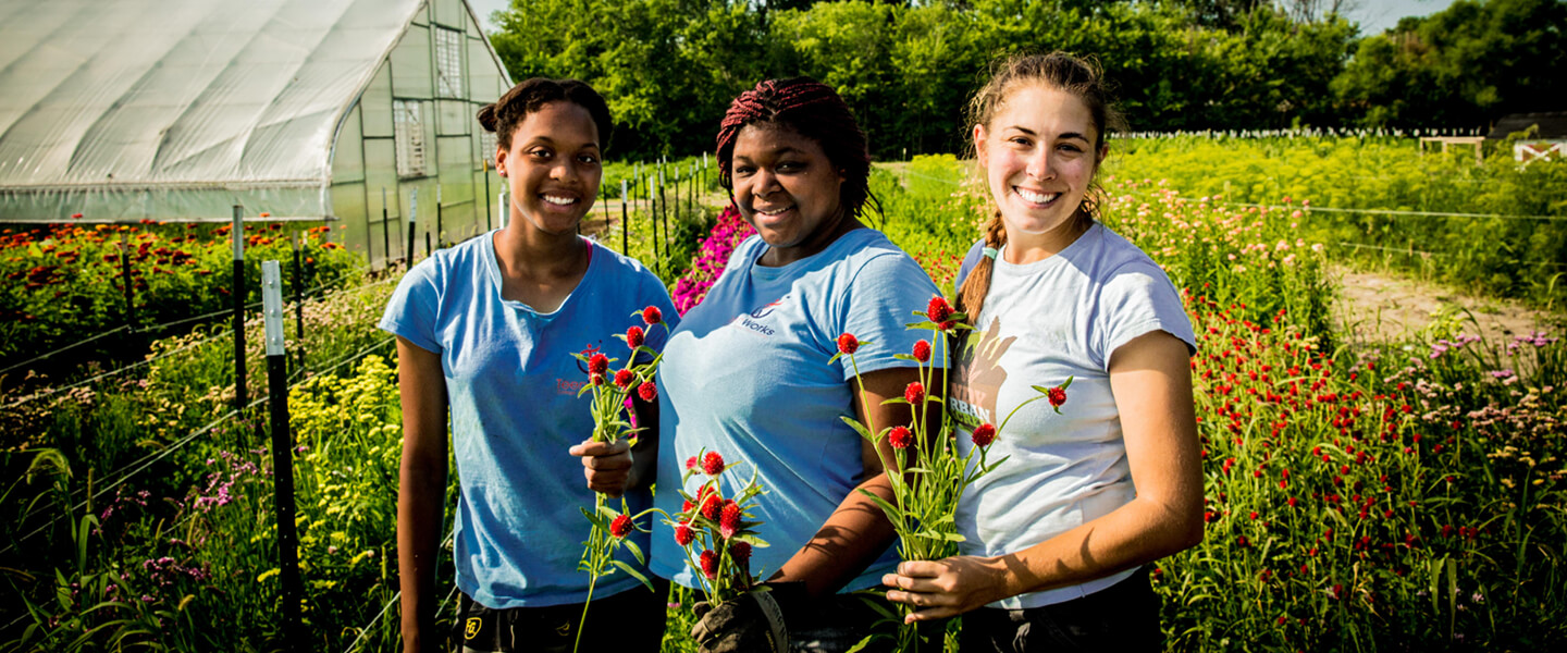 Group of ladies holding flowers at a flower farm